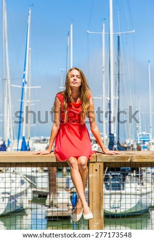 Beautiful urban girl on the pier in San Francisco - stock photo