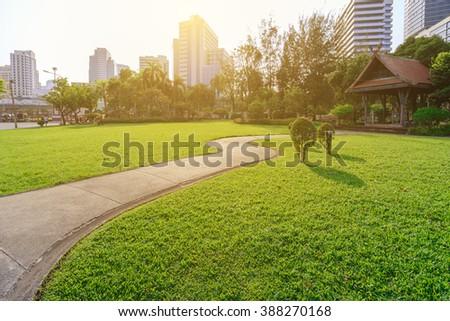 Beautiful urban park in sunny day of Bangkok city, Thailand. - stock photo