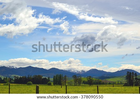 Beautiful valley with mountains in the backgroundn within New Zealand
