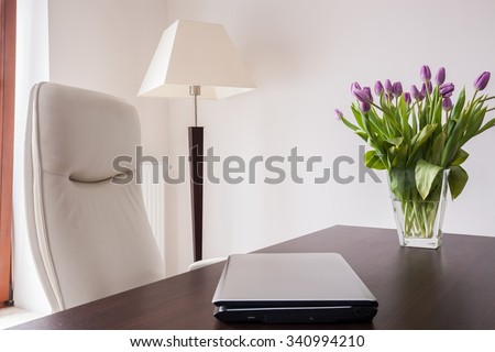 Beautiful vase with flowers on the desk