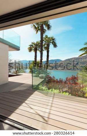 beautiful veranda overlooking the lake, view from interior - stock photo