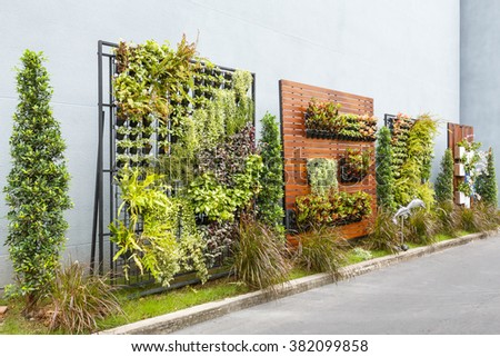 Beautiful vertical garden in city around office building - stock photo