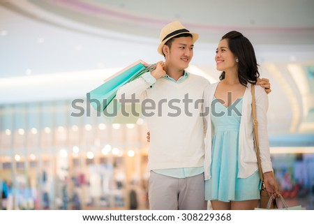 Beautiful Vietnamese couple in the shopping mall