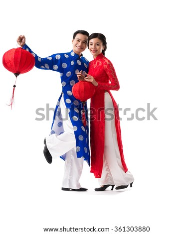Beautiful Vietnamese couple with red paper lanterns, isolated on white - stock photo
