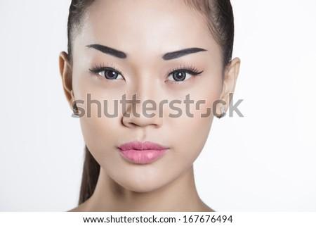 Beautiful Vietnamese girl closeup on face - stock photo