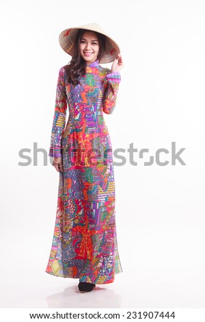 Beautiful Vietnamese woman with tradition ao dai with modern design and palm-leaf conical hat ( non la ) on white background - stock photo