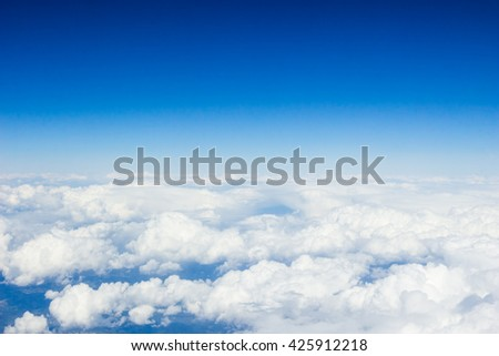 Beautiful view above clouds from airplane perspective - stock photo