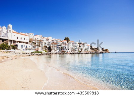 Beautiful view at Andros town with beach, Andros island, Cyclades, Greece - stock photo