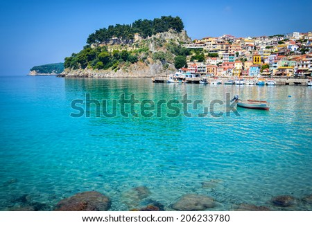 Beautiful view at Parga Fortress, traditional Greek houses and cristal clear Ionian sea water   - stock photo