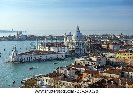 beautiful view from a height St Mark Campanile ( bell tower ) of the Grand Canal and Basilica Santa Maria della Salute in Venice, Italy - stock photo