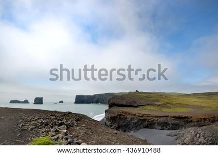 Beautiful view from Dyrholavegur, of black volcanic sand beach in Vik, Iceland - stock photo