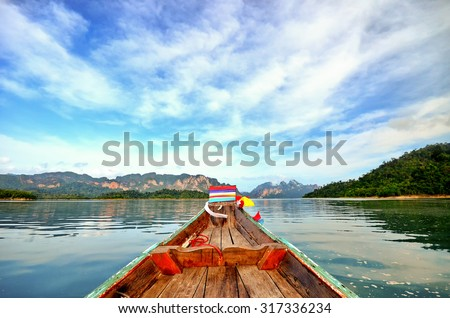 beautiful view mountain lake and river from long tail boat in Ratchaprapa dam , Khoa sok national park , Surat thani ,Thailand - stock photo