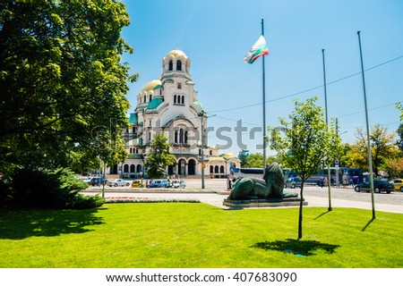 Beautiful view of Alexander Nevsky Cathedral, green grass and flag in Sofia, the capital of Bulgaria - stock photo