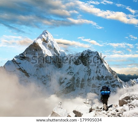Beautiful view of Ama Dablam with tourist and beautiful clouds - Sagarmatha national park - Khumbu valley - Trek to Everest base camp - Nepal - stock photo