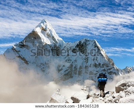Beautiful view of Ama Dablam with tourist and beautiful clouds - Sagarmatha national park - Khumbu valley - Trek to Everest base camp - Nepal