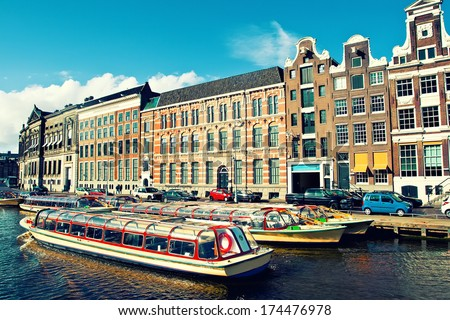Beautiful view of Amsterdam canals with boat, Holland - stock photo