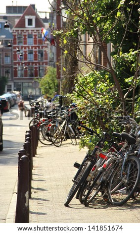 Beautiful view of Amsterdam street and lot of bicycles - stock photo
