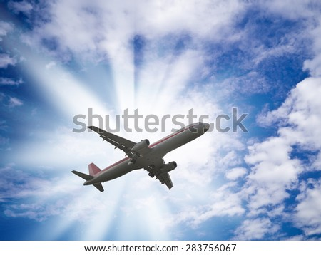 beautiful view of an airliner fly in cloudy sky