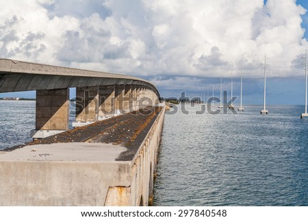 beautiful view of an old concrete bridge above the sea - stock photo