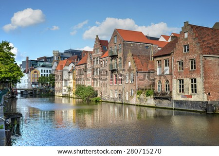 Beautiful view of ancient buildings with a blue sky and white clouds in Gent, Belgium - stock photo