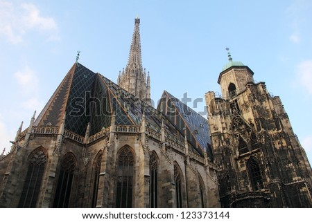 Beautiful view of ancient catholic basilica - St. Stephen's Cathedral (UNESCO World Heritage Site) at evening against the background of cloudy blue sky, Vienna, Austria, Central Europe - stock photo