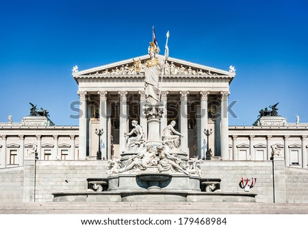 Beautiful view of Austrian parliament building with famous Pallas Athena fountain in Vienna, Austria