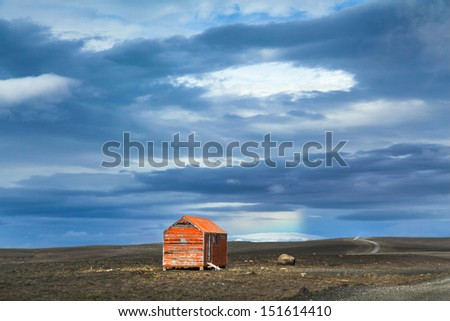 Beautiful view of barren landscape with old red snowstorm shelter at Kjolur highland road, Iceland - stock photo