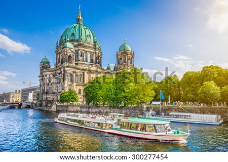 Beautiful view of Berliner Dom (Berlin Cathedral) at famous Museumsinsel (Museum Island) with excursion boat on Spree river in beautiful evening light at sunset, Berlin, Germany - stock photo