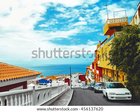 Beautiful view of bright colorful houses on blue sky background - stock photo