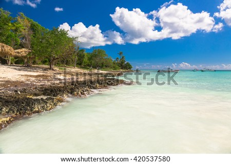 Beautiful view of Coral Beach and yacht on Saona, Dominican Republic. - stock photo