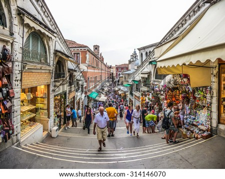 Beautiful view of crowded Streets of Venice from famous Rialto Bridge in Venice, Italy - stock photo