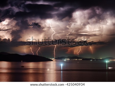 Beautiful view of dramatic stormy sky and lightning over Nha Trang Bay of South China Sea in Khanh Hoa province at night in Vietnam. Nha Trang city is a popular tourist destination of Asia. - stock photo