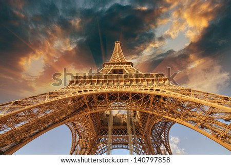 Beautiful view of Eiffel Tower in Paris with sunset colors.