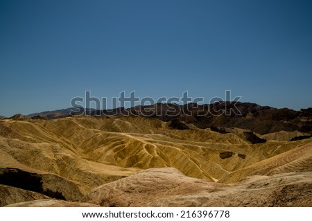 beautiful view of eroded ridges in death valley national park - stock photo