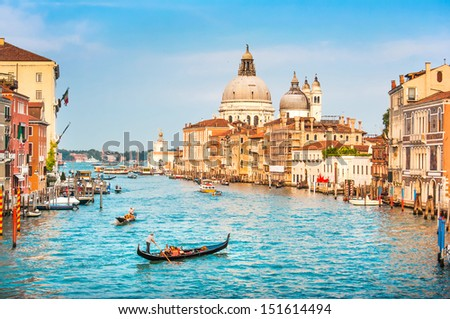 Beautiful view of famous Canal Grande and Basilica di Santa Maria della Salute at sunset in Venice, Italy - stock photo