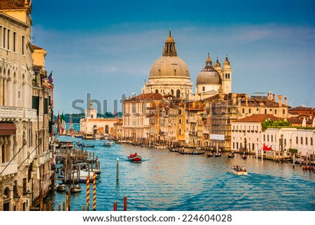 Beautiful view of famous Canal Grande with Basilica di Santa Maria della Salute at sunset in Venice, Italy - stock photo