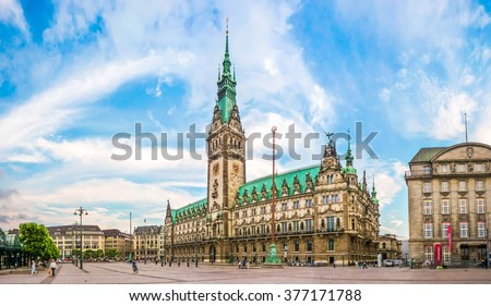 Beautiful view of famous Hamburg town hall with dramatic clouds and blue sky at market square near lake Binnenalster in Altstadt quarter, Hamburg, Germany - stock photo