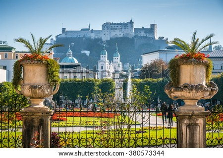 Beautiful view of famous Mirabell Gardens with the old historic fortress Hohensalzburg in the background in Salzburg, Austria - stock photo
