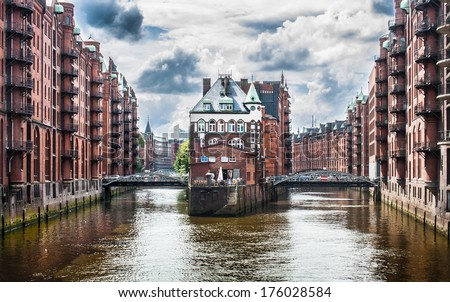 Beautiful view of famous Speicherstadt warehouse district with dark clouds before the storm in Hamburg, Germany - stock photo
