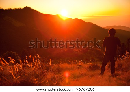 Beautiful view of grass field and Himalayan mountains in sunrise time when see from the top of Poonhill peak, Nepal - stock photo