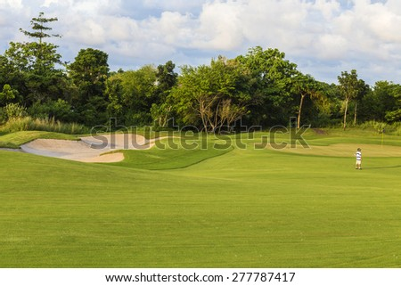 Beautiful View of Green Golf Field with Blue Sky.