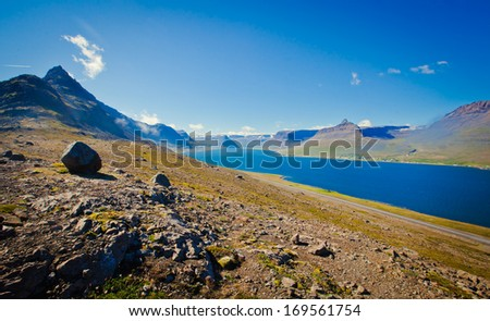 Beautiful view of icelandic fjord in iceland with scandinavian rocks
