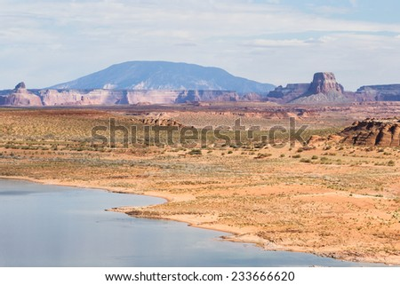 beautiful view of lake Powell with navajo Sandstone contrasting with the blue water - stock photo