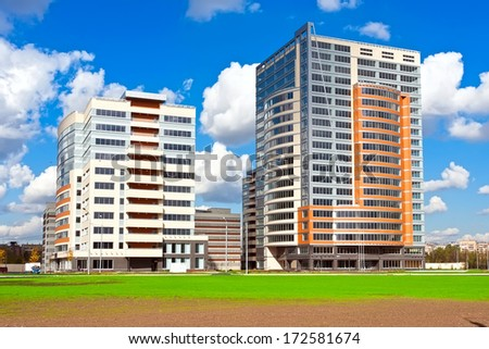 Beautiful view of modern apartment buildings under blue sky - stock photo