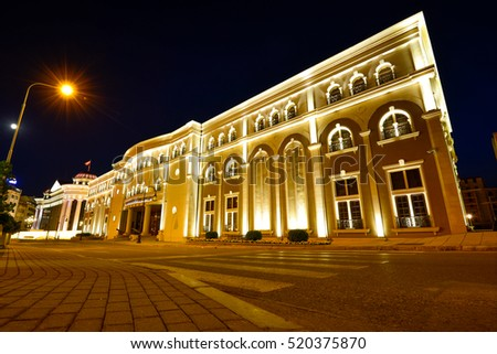 Beautiful view of Museum of the Macedonian Struggle building at night in Skopje, Macedonia.