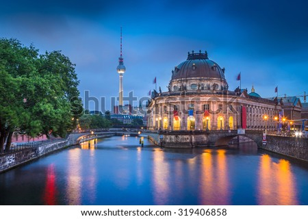Beautiful view of Museumsinsel (Museum Island) with famous TV tower and Spree river in twilight during blue hour at dusk, Berlin, Germany - stock photo