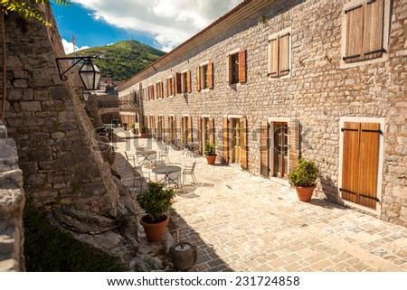 Beautiful view of narrow street at old city of Budva, Montenegro - stock photo