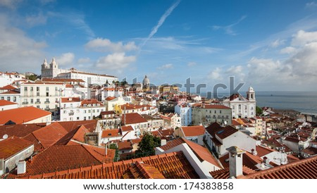 Beautiful view of old city from Alfama with cloudy sky. Lisbon, Portugal. - stock photo
