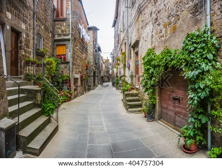Beautiful view of old traditional houses and idyllic alleyway in the historic town of Vitorchiano, province of Viterbo, Lazio, Italy - stock photo