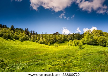 Beautiful view of rural alpine landscape. Sunny hills under cloudy sky. Upper Svaneti, Georgia, Europe. Caucasus mountains. Beauty world. - stock photo